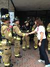 Senator Ayotte talks with firefighters before the 9/11 Memorial Stair Climb in Manchester, New Hampshire.